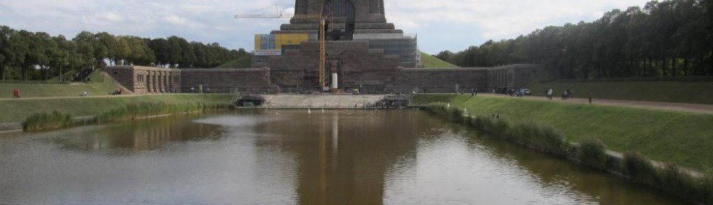 View of the monument across the reflecting poll in front of it.  The water in the reflecting poll is pretty muddy, which kind of ruins the effect.  The crane from renovation blocks portions of the view as well.