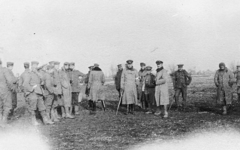 German & British Troops meeting in No Mans Land in Flanders on Christmas Day 1914. Image Courtesy of the Imperial War Museum
