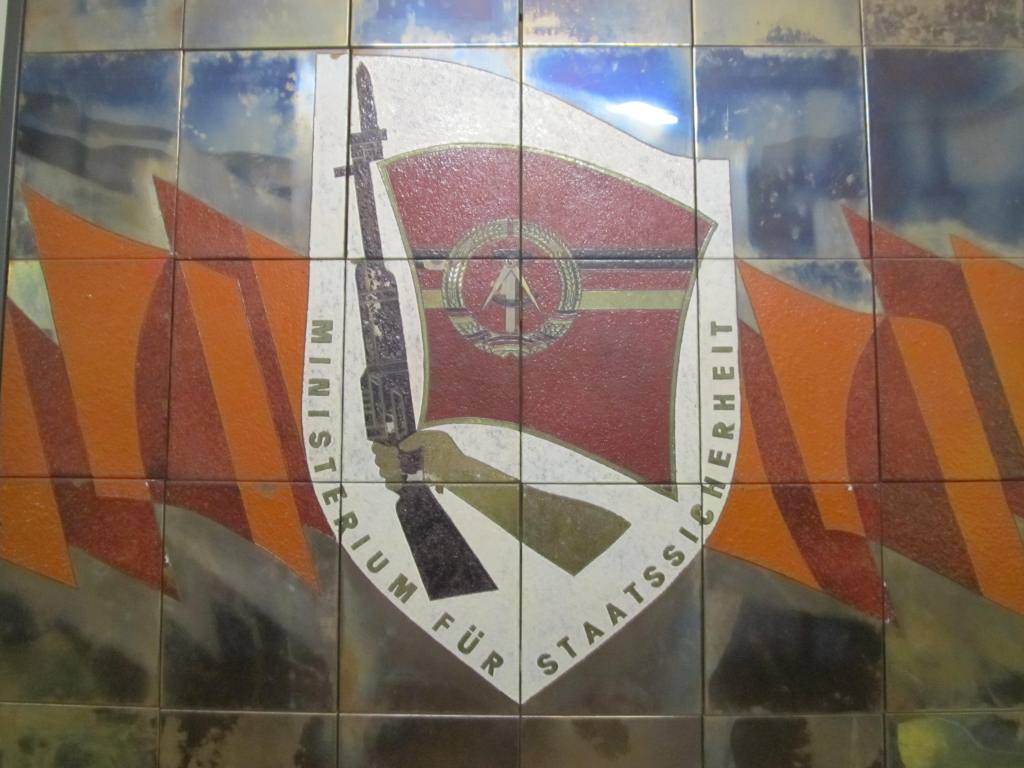 Mural of the Coat of Arms of the (Minsitry for State Security) Stasi just inside the entrance to the building.